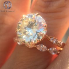 Here is close up of this beautiful round brilliant engagement ring and dainty wedding band. They were made for one another.