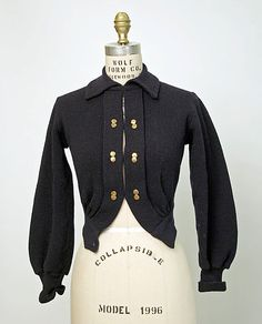 Sweater    Date:      ca. 1905  Culture:      British  Medium:      wool, metal  Dimensions:      Length at CB: 16 in. (40.6 cm)  Credit Line:      Isabel Shults Fund, 1986  Accession Number:      1986.181.1