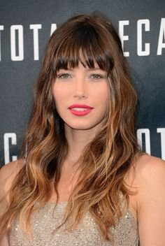 Jessica Biel from Total Recall showing off her bangs and ombre hair in a beachy style.