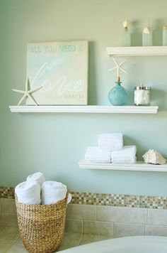 Floating display shelves with bubble bath, cotton balls, star fish and original art