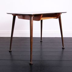 Delicately styled walnut & beech side table with shelf...