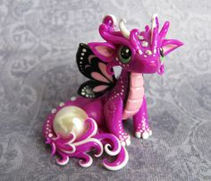 Baby Butterfly Dragon by DragonsAndBeasties.deviantart.com on @deviantART
