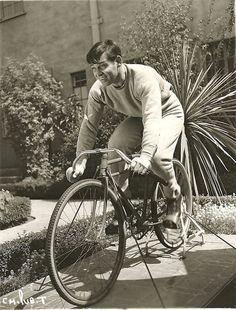 Clark Gable rides a bike. Stationarily.  Hmmm.