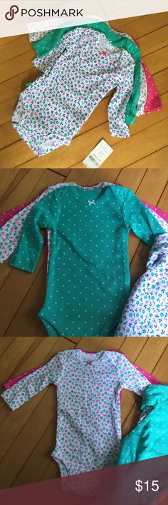4 Carter's long-sleeved onesies, girl's 3mo New With Tags! 4 adorable long-sleeved onesies from Carter's. One pink with polka dots, one teal green with polka dots, one with pink birds and green flowers, one with blue birds and flowers. So cute! Expandable neckline for easy dressing, snap crotch. All items from a clean, smoke-free home. Please feel free to ask any questions or make an offer! Carter's One Pieces Bodysuits
