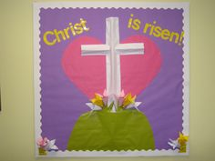 Sometimes I reuse parts of a bulletin board to create a new one. This Easter bulletin board used the heart and background paper from the February/valentine board. A few students who frequently check out the origami books were asked to create the lilies for the board.