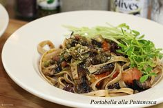 "Portabella alla Puttanesca. Culinary tradition says it was born among the ""working women"" of Syracuse, Italy. More reliable sources say it was borne of necessity when a restaurant owner found himself with many customers and few ingredients. Whichever is true, puttanesca is savory to the core. This version adds portabellas for extra mm-mmm. Start the water first, and by the time your pasta is done, so is your sauce."