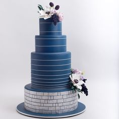 The top 10 wedding cake trends of 2018 include deep denim blue cakes, romantic botanical printed cakes, delicate swag cakes (think pearls and gold chains), bling and sparkle cakes, fresh lavender and ultra violet cakes, cakes with logos, artistic flair cakes, bright saturated colored cakes, oversized floral cakes, and tall white cakes. | wedding cake design | #weddinginspiratoin
