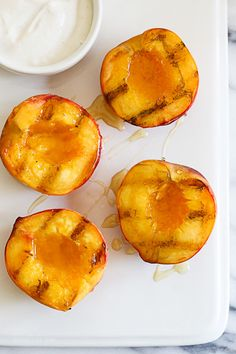 If you're looking for a quick an easy summer dessert under 100 calories, look no further!  Nothing says summer like biting into a juicy peach. Grilling them is a simple way to enjoy them as a dessert, a perfect ending to a backyard BBQ without heating up your kitchen. Delicious topped with yogurt and honey, but also great topped with low fat ice cream.       Grilled Peaches with Yogurt and Honey Skinnytaste.com Servings: 4 • Serving Size: 1/2 peach with 1 tbsp yogurt • Points +: 2 ...