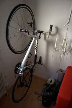 If you have only an apartment of 35 square meters, you need to rethink the arrangement of your furniture and belongings.   To store my bicycle, I used two Kvartal hooks from Ikea's as-is-section for $1.50 each. Two screws later, I was able to mount my bicycle.