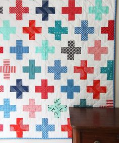 I will never tire of a simple plus quilt! I made this for a friends baby boy, it's one of my go-to baby quilts because I always know the Mom will like it. I stuck with blues and reds this time. Two co