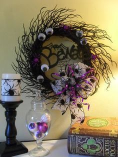Get a wooden round spray type wreath and spray paint it glitter black!