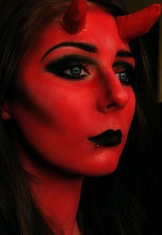 Mistress Molly red face paint contouring