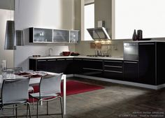 #Kitchen Idea of the Day: Glossy black cabinets in a modern luxury kitchen. By Latini Cucine. Great, black italian eureka glass cabinets stainless hood