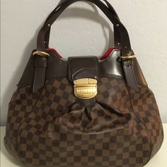 "LOUIS VUITTON Sistina Gm Tote Hobo Bag Brand: Louis Vuitton Style: Sistina  Type: Hobo Shoulder Satchel Handbag Size: GM Color: Brown Damier Monogram Measurements: Width 16.0"" Height 11.0"" Depth 6.0"" Handle Drop 9.0"" Product Details Type of Material: Coated Canvas Hardware: Brass Closure: Fold Over, Push Lock Includes: Dust Bag Condition: Good Preloved  Disclosures: Minor signs of wear, slight tarnish on hardware, minor exterior marks.   Lower prices on VeblenX.com & Tradesy Louis Vuitton…"