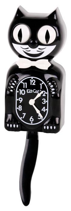 Kit-Cat Clock, SEK 495. DO WANT!