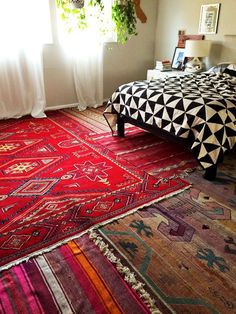 Layer area rugs over an ugly floor. Not only will it hide ugly linoleum, it feels cozy as hell!