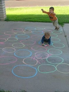 fun and simple side walk chalk game - draw a bunch of circles in different colors, while making paths. Make some paths harder then others! The idea is to choose a color and then jump in only that color as you make it to the other side.  Can make it a race too where each person chooses a color and then races across!