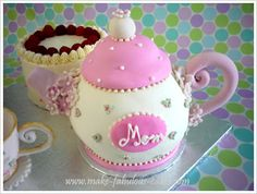 Tea Pot cake for the Tea Party Birthday! I can use the giant cupcake pan I already have and adjust from there :)