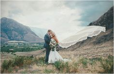 Mountain landscape photo with wedding couple along with a stunning vail. Beautiful BC Wedding  Joelsview Photography