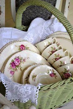 Basket with beautiful tea cups