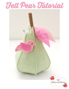 Stitch a Felt Pear Pin Cushion ~ Tutorial by Molly and Mama. Make this simple pear with these easy to follow instructions. You can stitch the little bird pin topper too!