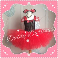 Minnie Mouse Tutu Dress.  Beautiful & lovingly handmade.  Price varies on size, starting from £25.  Please message us for more info.  Find us on Facebook www.facebook.com/DiddyDarlings1 or our website www.diddydarlings.co.uk