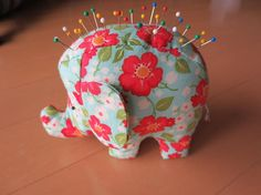 Patterned Elephant Pincushion with Pins --http://www.craftsy.com/blog/2013/10/pincushion-patterns/?ext=FB_QC_PP_Reg_BlogPincushion_20131005&utm_source=Page%20Post-Quilting%20Club&utm_medium=Registration&utm_campaign=Facebook&initialPage=true