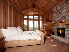 Not only does this bedroom have dramatic views from its tower of windows, but there's a natural stone fireplace at the foot of the bed. The lesson? Always position your bed to maximize the view outside.
