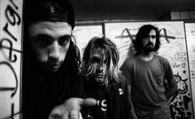 12-11-1991 Frankfurt Nirvana. Left to right Dave Grohl (drums), Kurt Cobain (vocals/guitar) and Krist Novoselic (bass). Grunge from Seattle  Copyright Paul Bergen