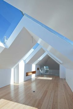 Loft at Fonte Da Luz, Oporto, Portugal by Barbosa & Guimarães great roof windows, better than velux
