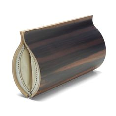 A handsome purse to compliment the bamboo stems. (This choice is a bit more affordable than my dream McQueen purse suggestion) I found this one at http://www.woodshoppeinc.com/wood-hips-clutch-ebony.