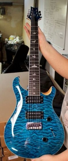 PRS SE Custom 24 7 String. 1 of 25
