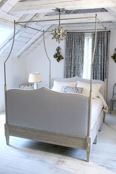 I love this simple bedroom and especially the canopy bed with its mix of wood, upholstery, and iron