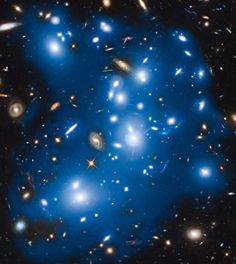 The galaxy cluster Abell 2744 takes on a ghostly look where total starlight has been artificially colored blue in this Hubble view. Image credit: NASA / ESA / IAC / HFF Team / STScI.