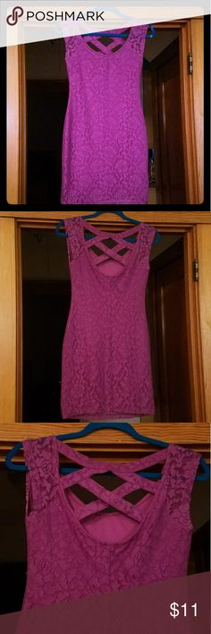 "Purple/pink lace fitted dress Purple/pink Nollie (a PacSun brand) dress that is lacey with a criss cross upper back. Size small. This dress is fitted and perfect when you want to look sexy! I wore it out a lot in college. I was 120 lbs and 5'2"" and you can refer to the last photo to see how it fit me. I always got lots of compliments on it! It's in excellent used condition! The lighting in my house is not great in the evening (when I took these pictures) but the dress's color is most…"