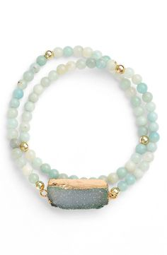 Accessorize a guest-of-the-wedding outfit with this eye-catching, 18-karat gold-plated drusy stone bracelet.