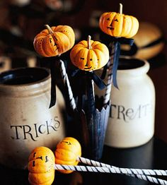 Pumpkin on a Stick  http://www.bhg.com/halloween/parties/haunt-the-house-for-an-old-fashioned-halloween-party/#page=11