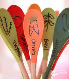 Make your very own garden markers by using wooden spoons, paint and a sharpie