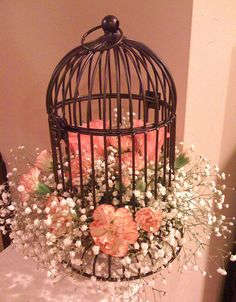 Spring birdcage with roses, baby's breath & mini carnations