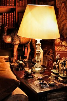 Coco Chanel's Paris apartment is illuminated almost exclusively with rock crystal table lamps, candlesticks & chandeliers.