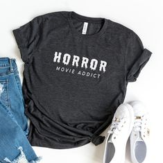 """This """"Horror Movie addict"""" design is printed on Bella-Canvas 3001 Unisex T-Shirt using eco-friendly fabric ink. This t-shirt is everything you've dreamed of and more. It feels soft and lightweight, with the right amount of stretch. It's comfortable and flattering for both men and women. • 100% combed and ring-spun cotton (Heather colors contain polyester) • Ash color is 99% combed and ring-spun cotton, 1% polyester • Heather colors are 52% combed and ring-spun cotton, 48% polyester • Athletic an Funny Shirts Women, Funny Shirt Sayings, Tees For Women, Shirts With Sayings, Cute Shirts, Funny Tshirts, Fall Shirts, Sassy Shirts, Shirt Quotes"""