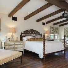 Spanish Colonial-Style Home - Phoenix Home & Garden. Carved wood bed. Wood beams
