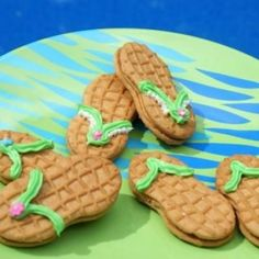 Flip Flop Cookies    Turn some Nutter Butter cookies into cute flip flops for your summer snacking.  The post will also show you how to turn the cookies into ballet slippers and soccer cleats as well.  All fun snacks and great treats for a party.