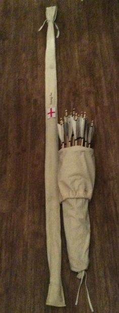 English longbow and arrows in a Medieval style quiver/arrow bag.