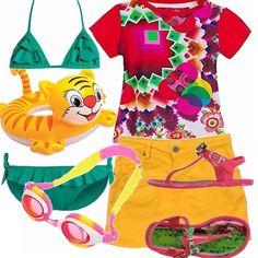 Un outfit coloratissimo per una giornata al mare all'insegna dei colori che piacciano tanto alle bambine! Costume due pezzi verde con voulant, t-shirt coloratissima, gonnellina giallo sole, sandali infradito rosa e verdi. Non possono mancare il salvagente e gli occhialini da mare!