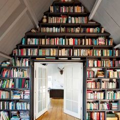 a wall of bookshelves is so much better then wall paper...
