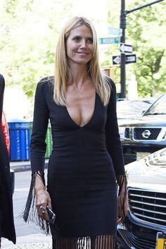 Heidi Klum wore a low-cut black dress as she arrived at the the Greenwich Hotel in New York City on Sept. 10.