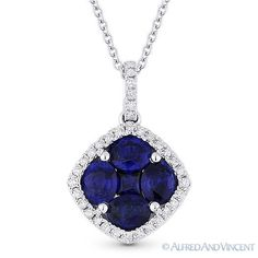 The featured pendant is cast in 18k white gold and showcases a pendant adorned with oval cut & princess cut blue sapphires set at the center of halo settings adorned with round cut diamond accents.   #diamonds #18kjewelry #18kgold #whitegold #sapphire #pendant #necklace