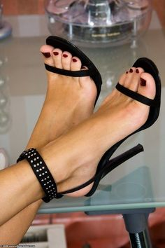 Studded strap black high heel sandals                                                                                                                                                     More