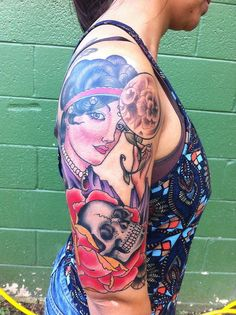 This is my gypsy fortune teller done by Kevin Stress at Blood, Sweat & Tears in Charlotte, NC.My 1/2 sleeve is not completely done yet I am adding a cameo and roses to the inside of my arm. This pic was taken right after we finished, I sat for 6 hours. The skull represents my past and the gypsy is all about what will happen.